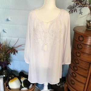 Delicate long white blouse with embroidered front